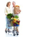 Senior couple with a grocery shopping cart isolated on white background Royalty Free Stock Images