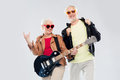 Senior couple with guitar showing rock hand sign Royalty Free Stock Photo