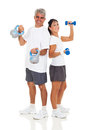 Senior couple gym cheerful posing with various equipment on white background Royalty Free Stock Photography