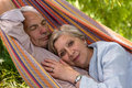 Senior couple in hammock love lying Royalty Free Stock Photos