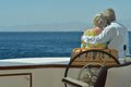 Senior couple having boat ride amusing elderly have a in a on sea Royalty Free Stock Images
