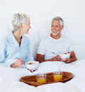 Senior couple having bowl full of fruits and juice Stock Photo