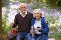 Senior Couple Having Break On Walk Through Bluebell Wood Royalty Free Stock Photo