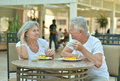 Senior couple having breakfast happy in cafe Royalty Free Stock Photography