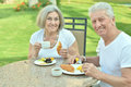 Senior couple having breakfast happy in cafe Royalty Free Stock Image