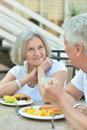 Senior couple having breakfast happy in cafe Stock Images