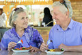 Senior couple having breakfast happy in cafe Stock Photos