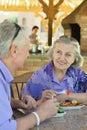 Senior couple having breakfast happy in cafe Royalty Free Stock Photography