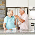Senior couple having breakfast happy in kitchen with toast and milk Royalty Free Stock Photo