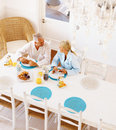 A senior couple having breakfast in the morning Royalty Free Stock Photography