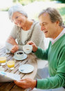Senior couple having a cup of coffee Royalty Free Stock Photos
