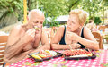 Senior couple having fun eating season fruit in thai restaurant Royalty Free Stock Photo