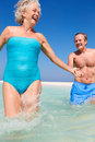 Senior couple having fun sea beach holiday smiling Royalty Free Stock Photography