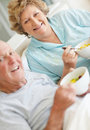 Senior couple holding a bowl of fruit salad Royalty Free Stock Photo