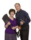 Senior couple holding gardening tool over white background Stock Photo