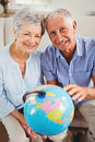 Senior couple holding a globe Royalty Free Stock Photo