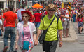 Senior couple holding hands in crowd ottawa canada july a walking among the during canada day on july downtown ottawa ontario Royalty Free Stock Images