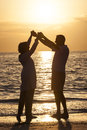Senior Couple Holding Hands Sunset Tropical Beach Royalty Free Stock Photo