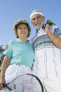 Senior Couple Holding Tennis Racquet And Balls Royalty Free Stock Photo