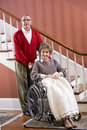 Senior couple at home, woman in wheelchair Stock Photo