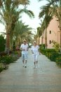 Senior couple at hotel resort run tropic Stock Image