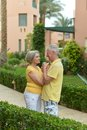 Senior couple at hotel resort run tropic Royalty Free Stock Photography