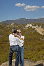 Senior couple hug with desert in background Stock Photography