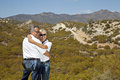 Senior couple hug with desert in background Royalty Free Stock Photo