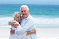 Senior couple hugging each other at the beach Royalty Free Stock Image