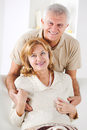 Senior couple hugging in living room Stock Image