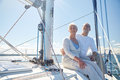 Senior couple hugging on sail boat or yacht in sea sailing age tourism travel and people concept happy deck floating Royalty Free Stock Photos