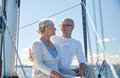 Senior couple hugging on sail boat or yacht in sea sailing age tourism travel and people concept happy and talking deck floating Royalty Free Stock Photos
