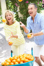Senior Couple Juggling Oranges Stock Images