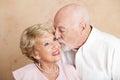 Senior Couple - Kiss on the Cheek Royalty Free Stock Photo
