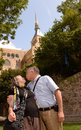 Senior couple kissing with old church building in background Stock Photography