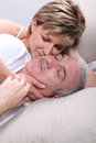 Senior couple laid in a bed Royalty Free Stock Image