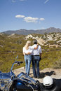 Senior couple look out to desert mountains Royalty Free Stock Photos