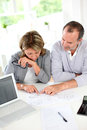 Senior couple looking at construction plan reading in office Royalty Free Stock Photography