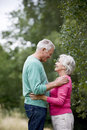 A senior couple looking into each other s eyes outdoors Royalty Free Stock Image