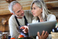 Senior couple looking for recipe on internet in home kitchen at tablet Royalty Free Stock Image