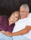 Senior couple in love in bed a hotel room Royalty Free Stock Photos
