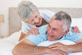 Senior couple lying in bed happy at home Royalty Free Stock Image
