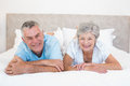 Senior couple lying in bed at home portrait of happy Stock Photography