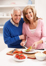Senior Couple Making Sandwich In Kitchen Royalty Free Stock Photo