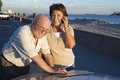 Senior Couple With Map On Vacations Stock Photos