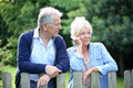 Senior couple outdoors standing by the fence Royalty Free Stock Photo