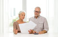 Senior couple with papers and calculator at home Royalty Free Stock Photo