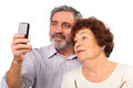 Senior couple photograph on mobile phone Stock Photo
