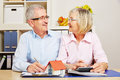 Senior couple planning mortgage financing happy together for building a house Stock Photo