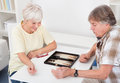 Senior couple playing backgammon happy game of at home Royalty Free Stock Images